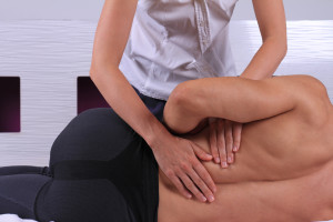 Chiropractic, osteopathy, manual therapy. Therapist doing healing treatment on man's back . Alternative medicine, physiotherapy, pain relief concept