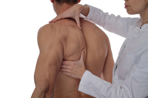 Chiropractic, osteopathy, manual therapy, acupressure. Therapist doing healing treatment on man's back, isolated. Alternative medicine, pain relief concept